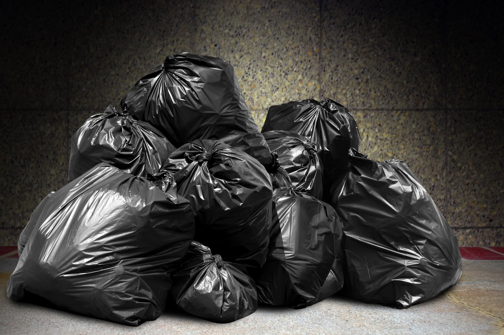 garbage is pile lots dump, many garbage plastic bags black waste at concrete wall, pollution from trash plastic waste garbage, bags bin of plastic waste, pile of garbage waste, lots of junk dump